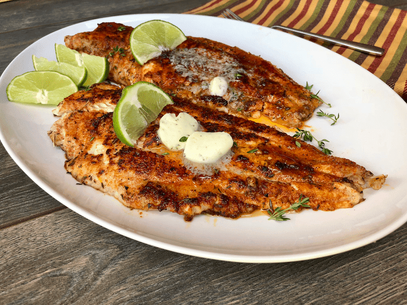 Blackened Catfish with Herbed Garlic Butter is a great alternative to fried catfish. With homemade blackened seasoning, this is a spicy option for the camp fire, grill, or cast iron skillet.