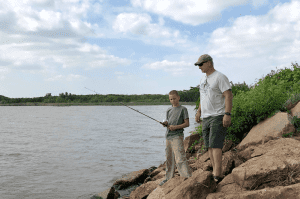 Boy and Dad Fishing - Take dad fishing and then enjoy this Blackened Grilled Catfish