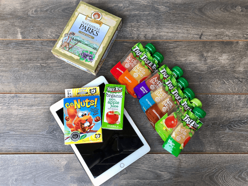 apple sauce and juice pouches, ipad, and travel games