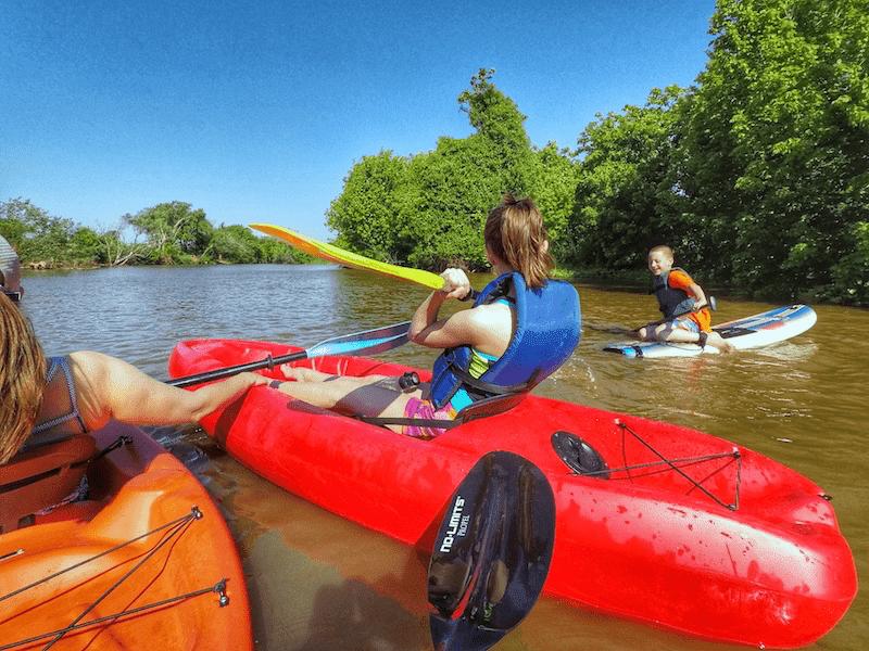 Kids kayaking on the river