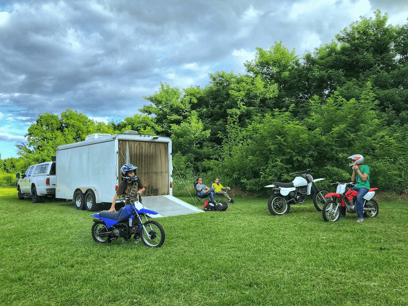 boys on dirt bikes and the family sits back to relax, trailer hauled with a B&W trailer hitch