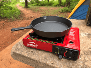 Camp Chef Butane camping stove and cast iron skillet - Ensure Your Next Family Camping Trip is Epic with these Summer Planning Tips