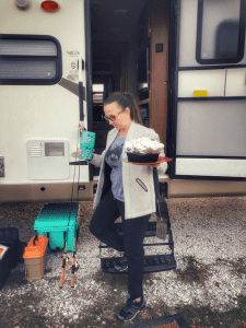 woman walking out the rv with food