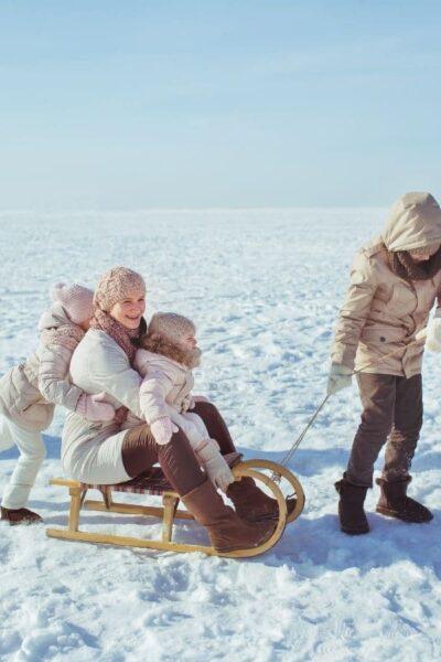 family sledding outside