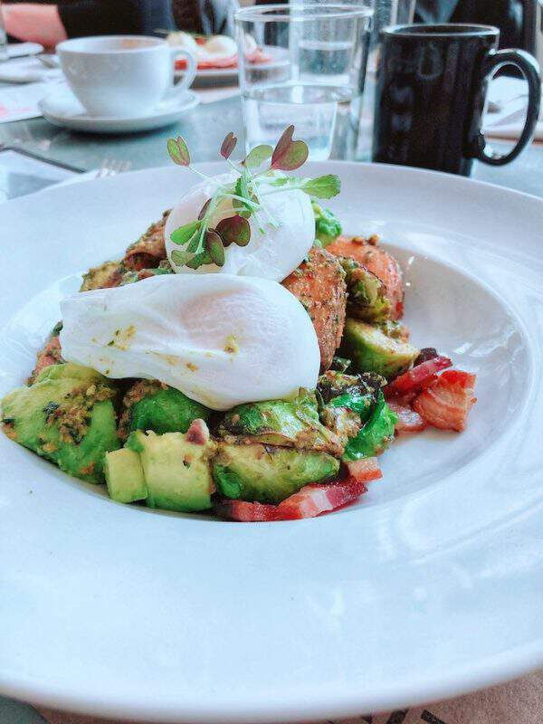 Breakfast Bowl with roasted vegetables and poached egg
