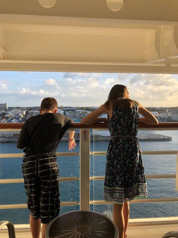 Children on cruise stateroom balcony