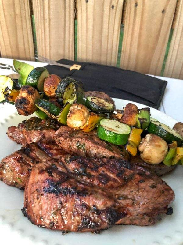 Grilled petite sirloins and vegetables with chimichurri