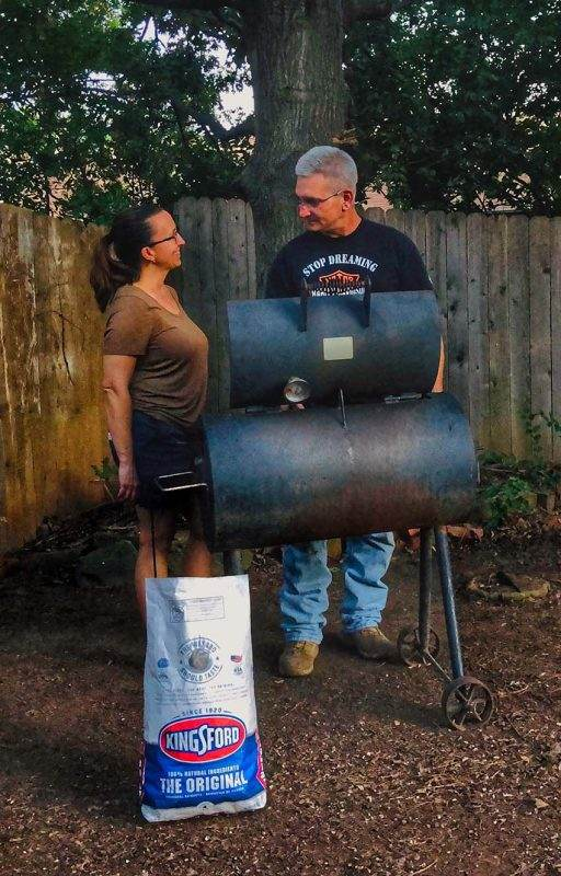 man and woman grilling