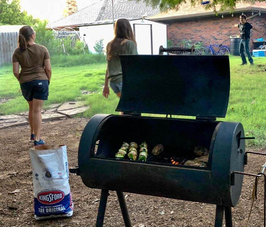 family bacyard grilling