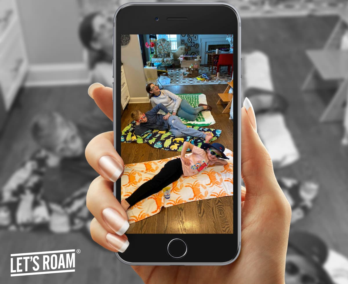smartphone screen showing family laying on floor