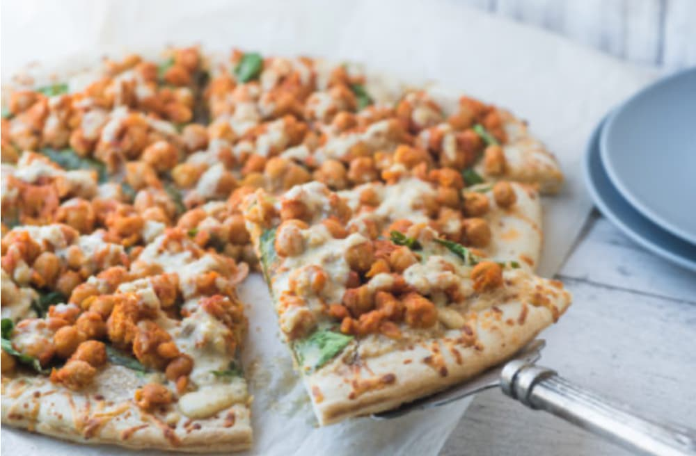 buffalo chickpea pizza with garlic sauce