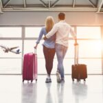 couple in airport with luggage