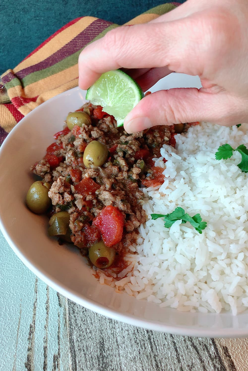 lime squeezed over picadillo and rice