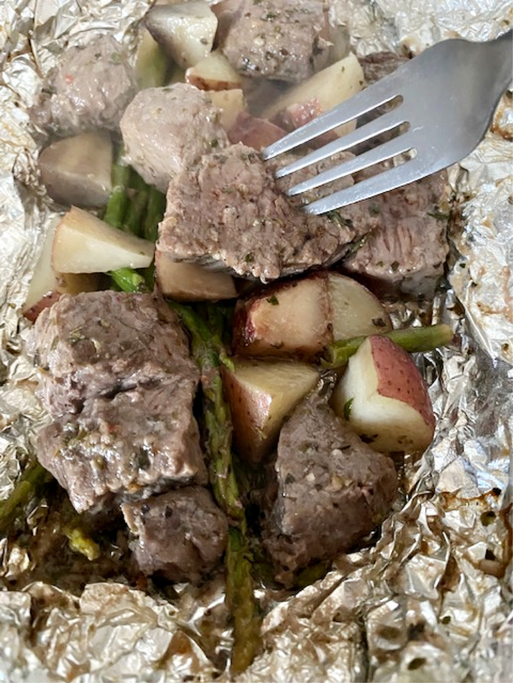 steak and potatoes in foil