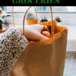 grocery bag with hand reaching in