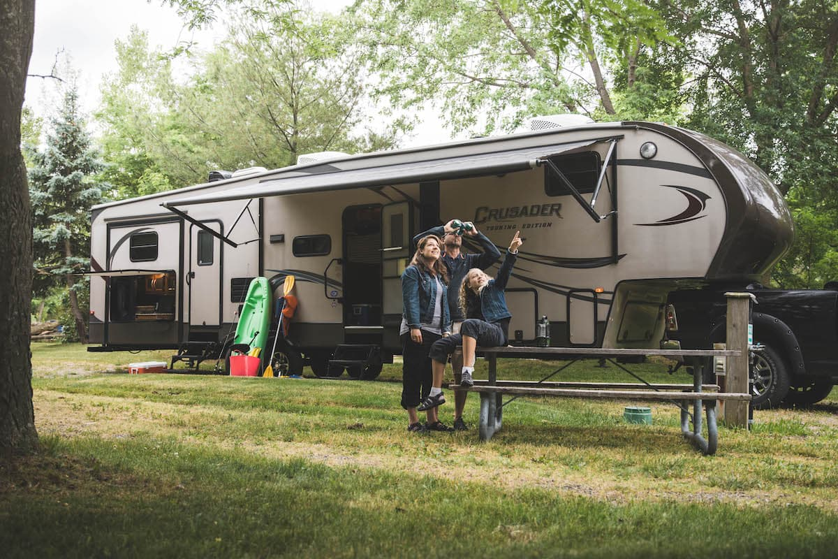 family outside an RV