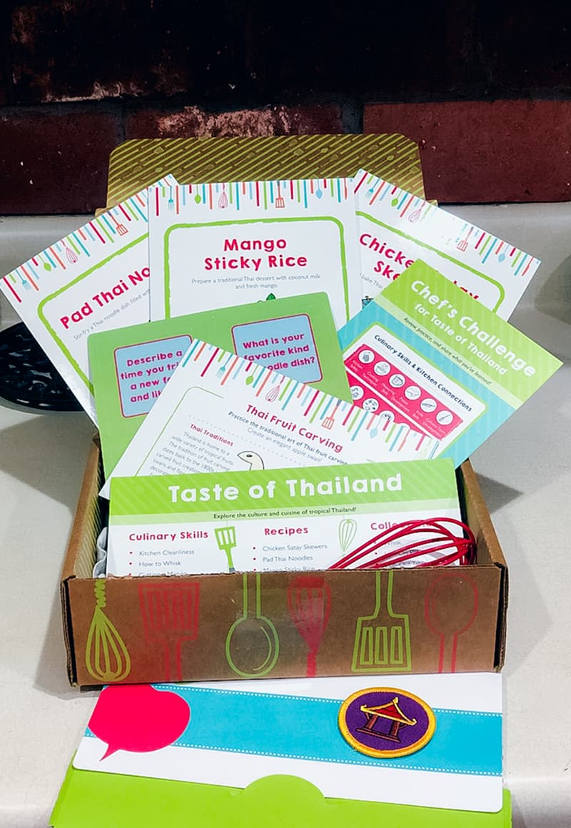 Raddish Kids subscription box with cards and whisk