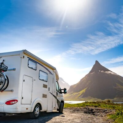 RV on dirt road with bicycles on back