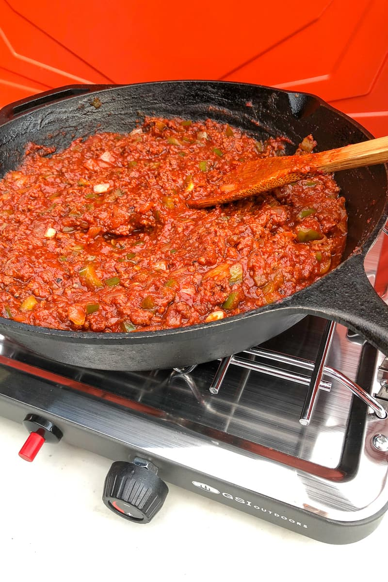 tomato based sauce cooking in skillet on portable stove