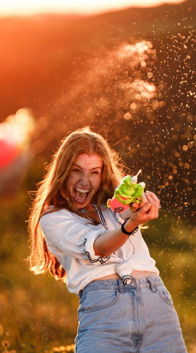 water gun fight woman