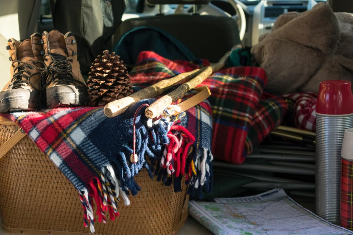 picnic basket, hiking boots, and blankets