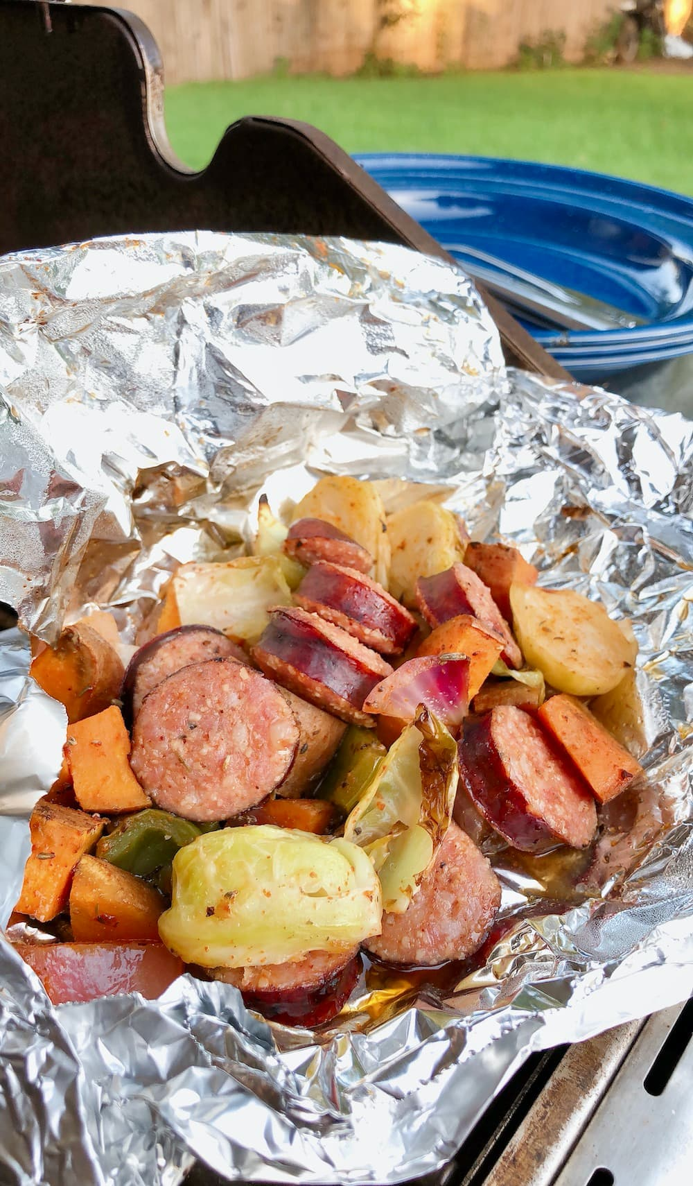 foil meal with sausage and veggies on grill