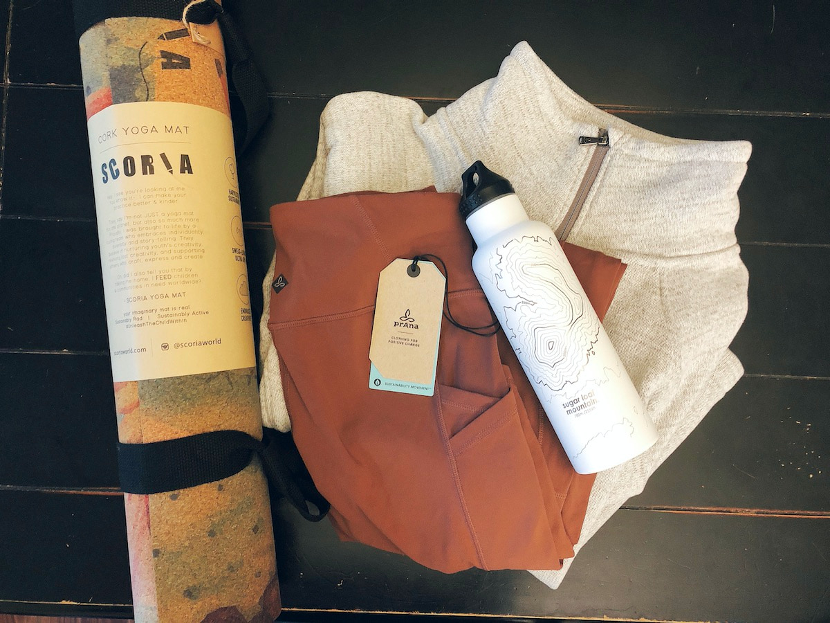 yoga mat, clothes and water bottle