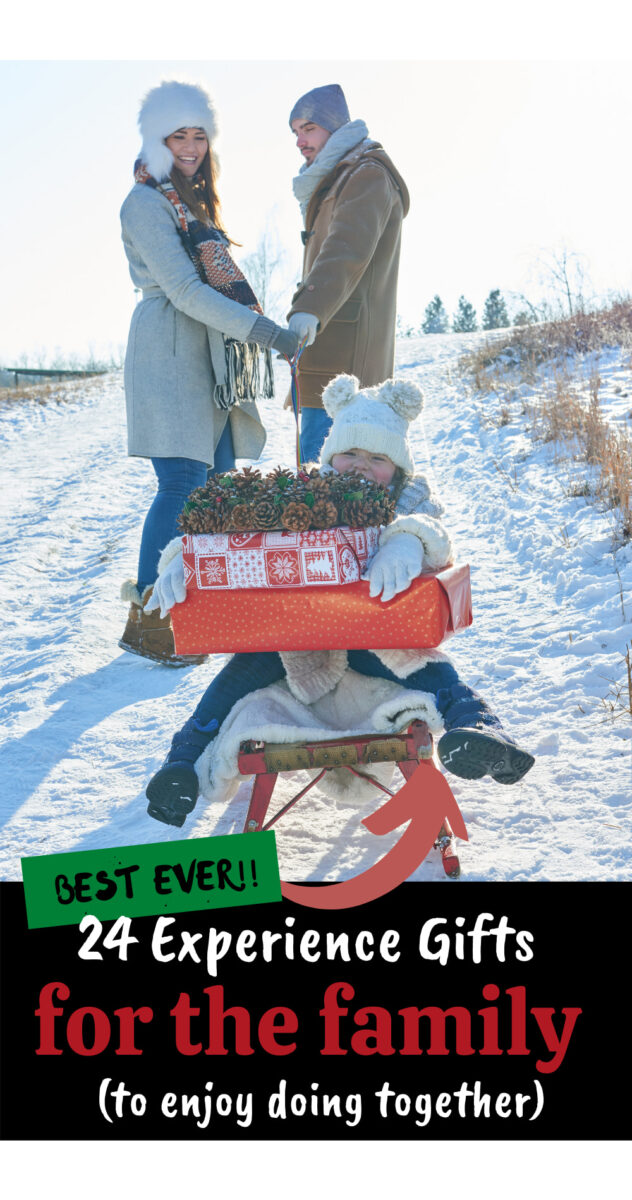 parents pulling a child on a sled with gifts