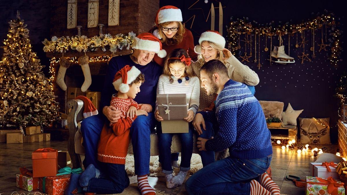 family opening up one shiny gift