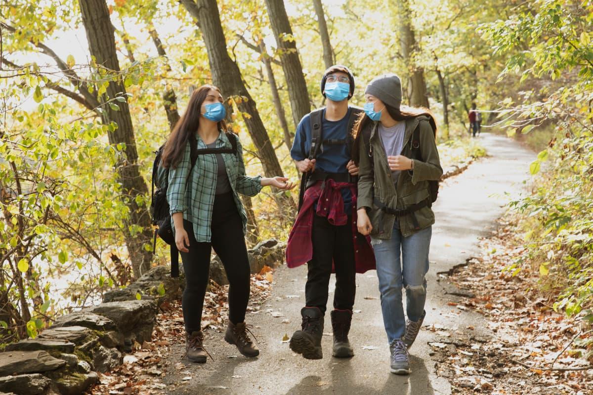 teen hiking in masks