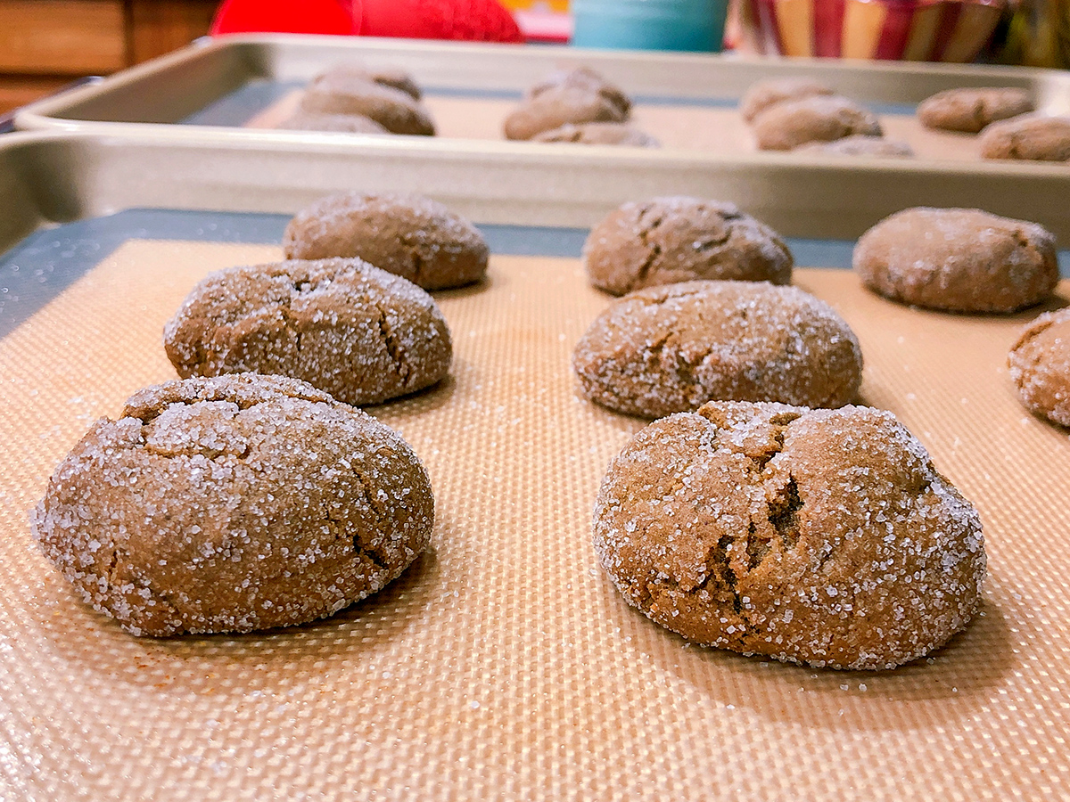 soft molasses crinkle cookies on baking sheet