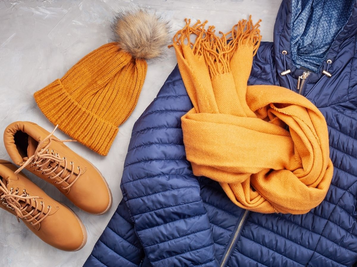 hat, boots, scarf, and winter jacket