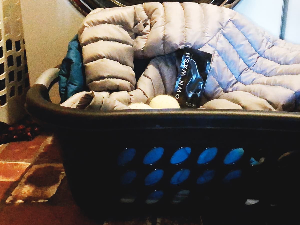 laundry basket with jackets and dryer balls