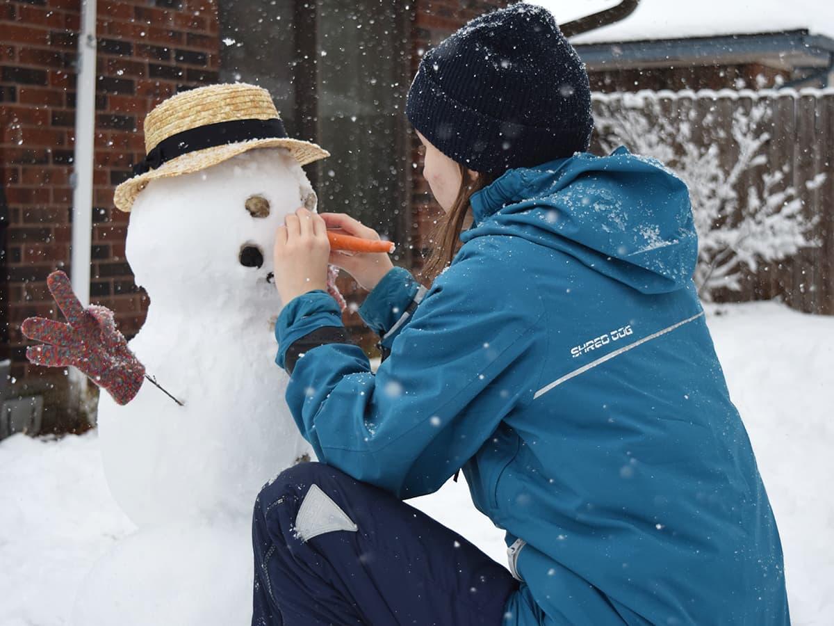 girl building a snow man