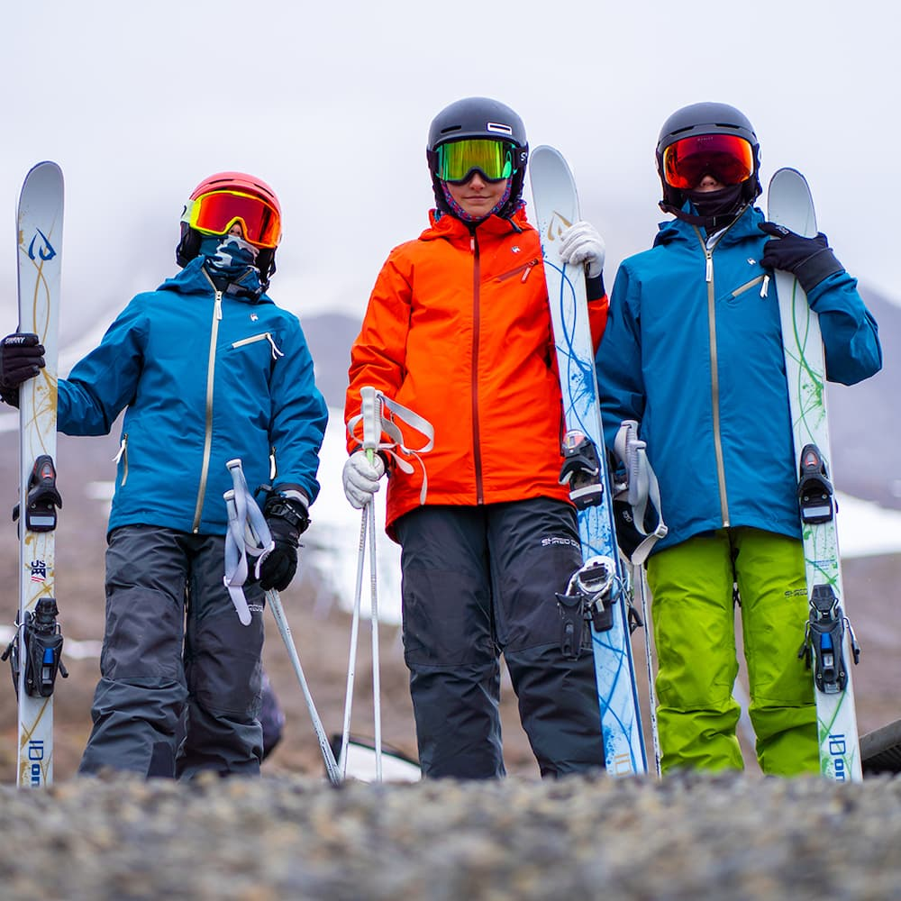 youth skiiers and snowboarder