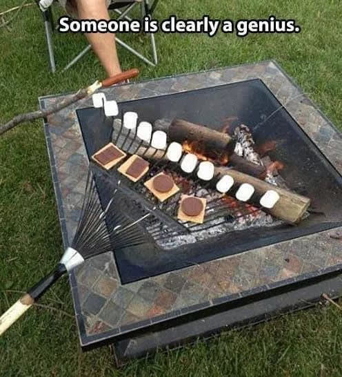 smores on a rack over campfire