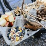 Close up Recycled Bird Feeder with seed and nesting material