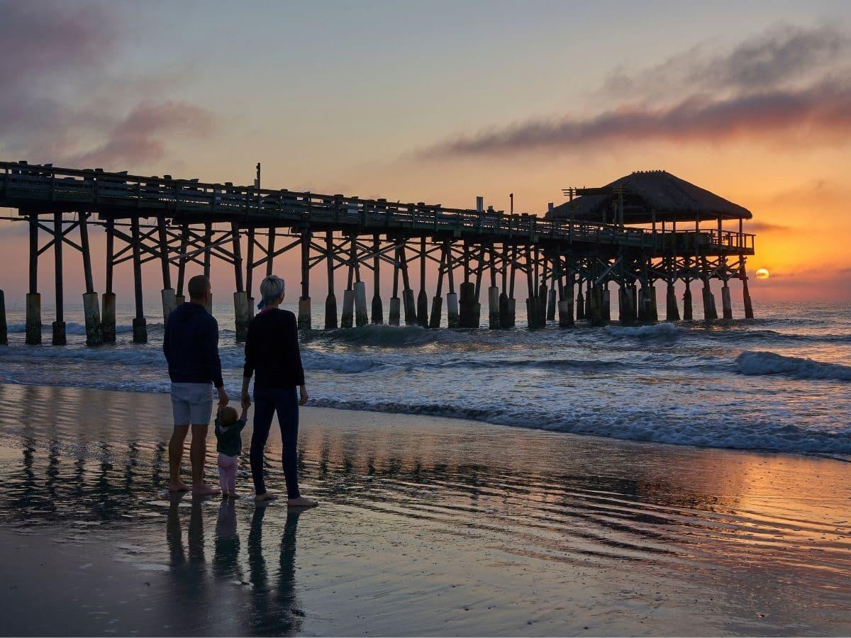 cocoa beach pier, family at ocean