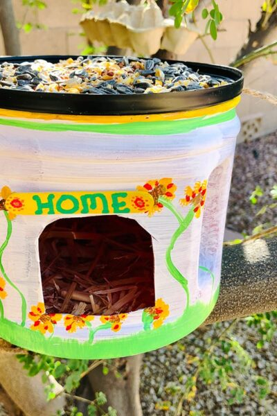 recycled coffee can bird feeder in tree