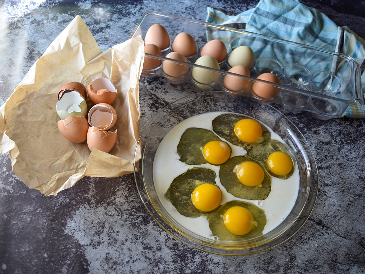 eggs and milk in shallow dish, eggs in cart, eggshells