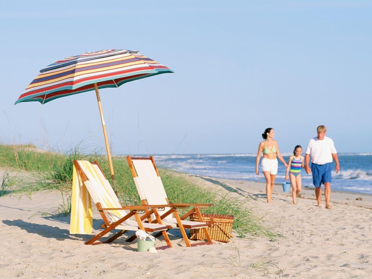 beach chairs, family walking on beach
