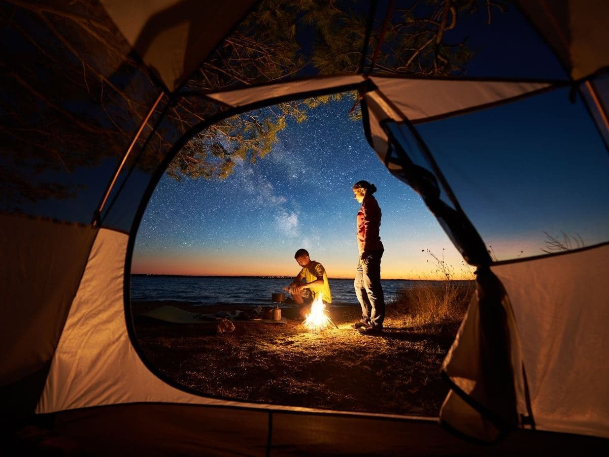 camping fire couple