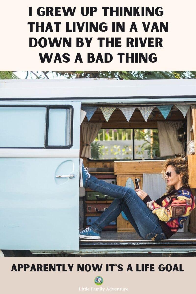 woman in van in phone - van life