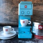 espresso machine, cups, coffee canister