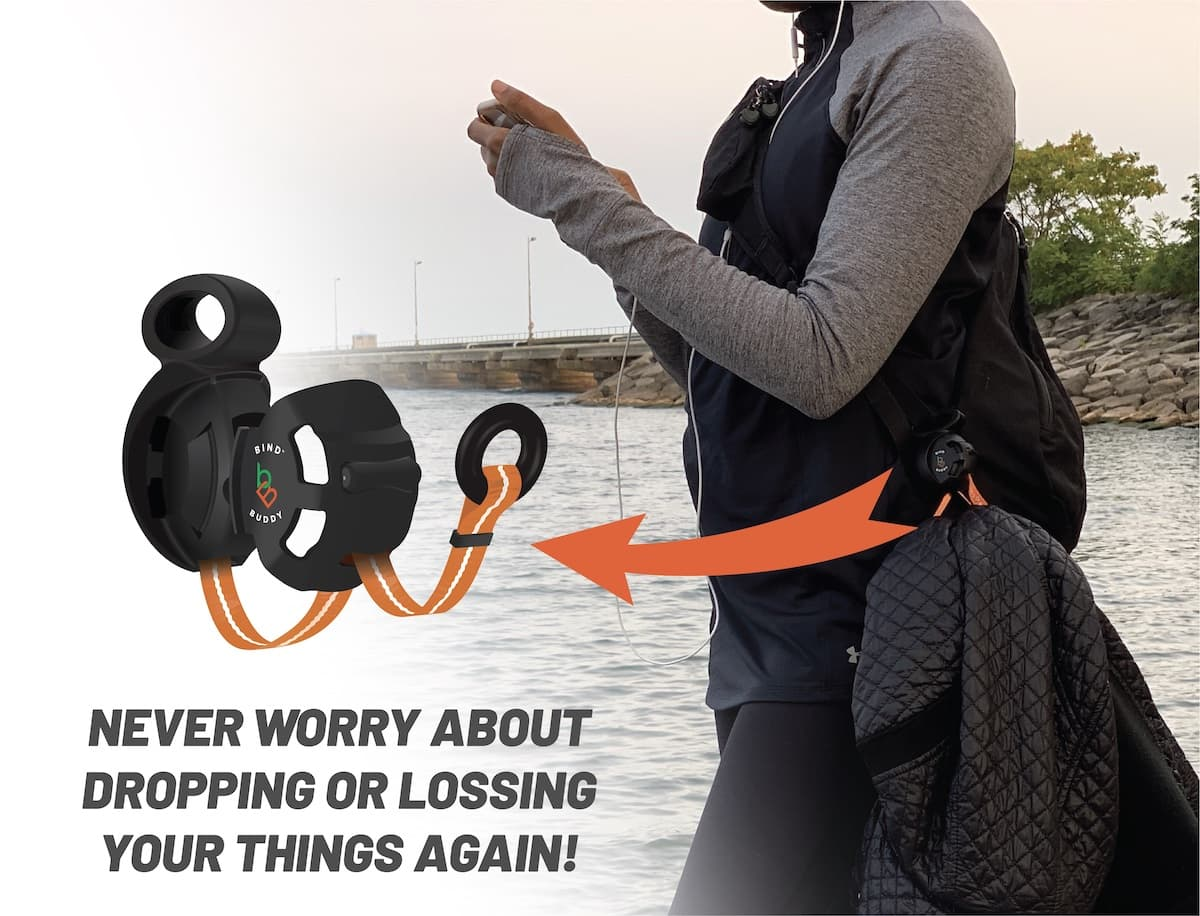 woman by lake, jacket hanging from clip