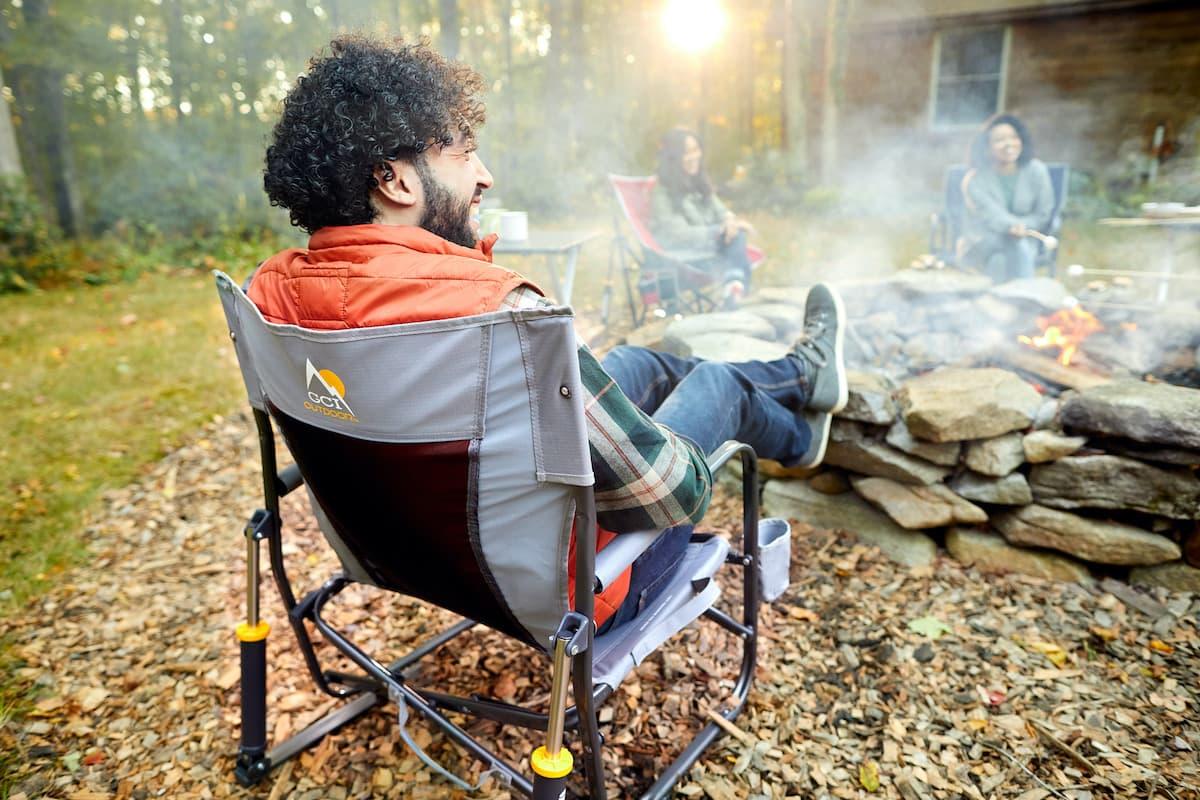 man outdoor in rockert by campsite