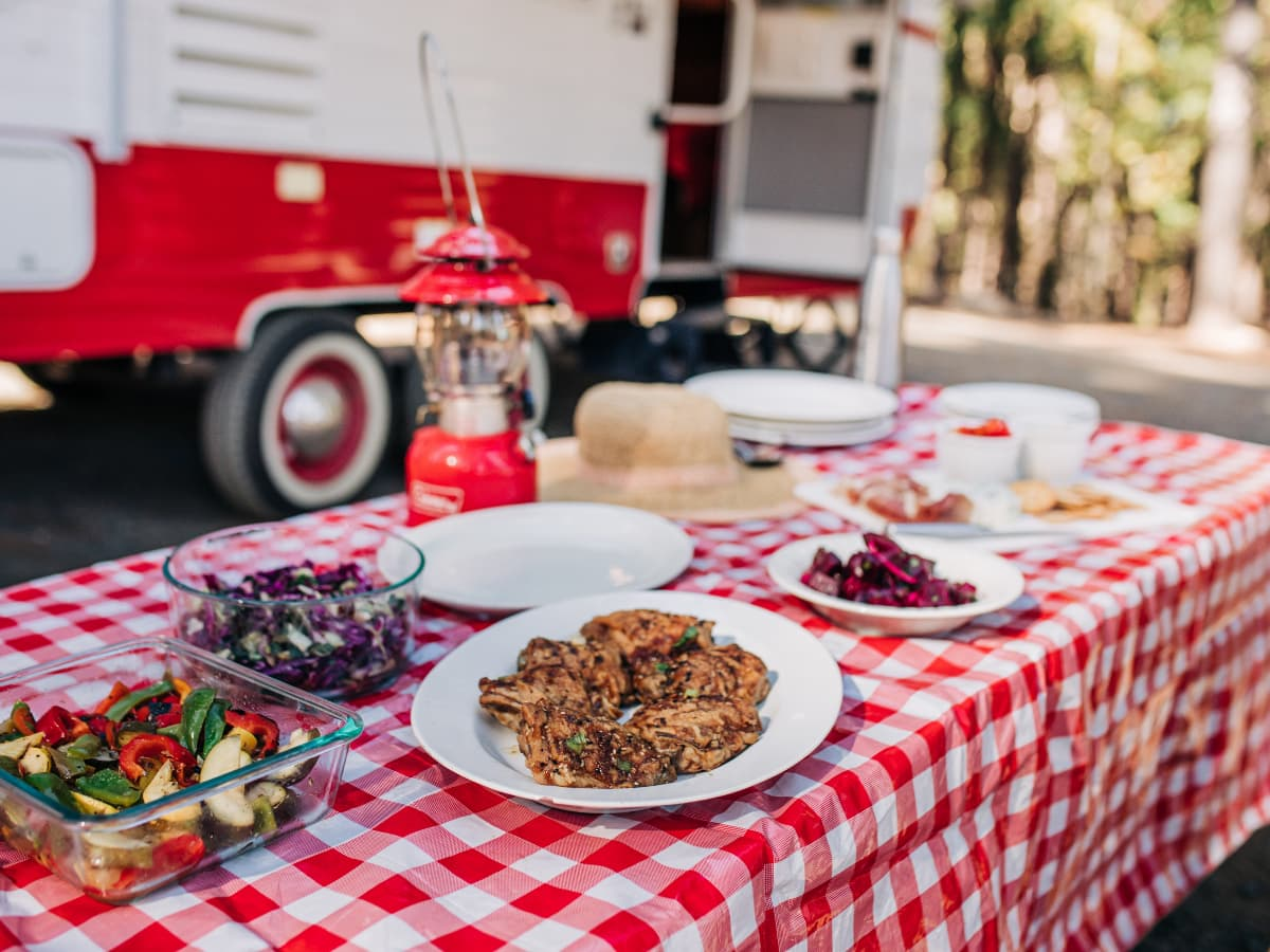 picnicn table with food in front of RV