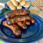 grilled brats on plate