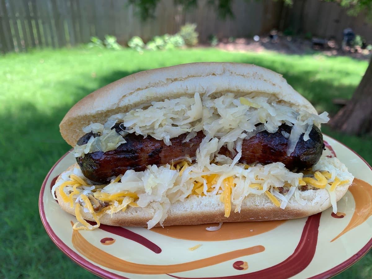 bratwurst on bun with kraut and mustard