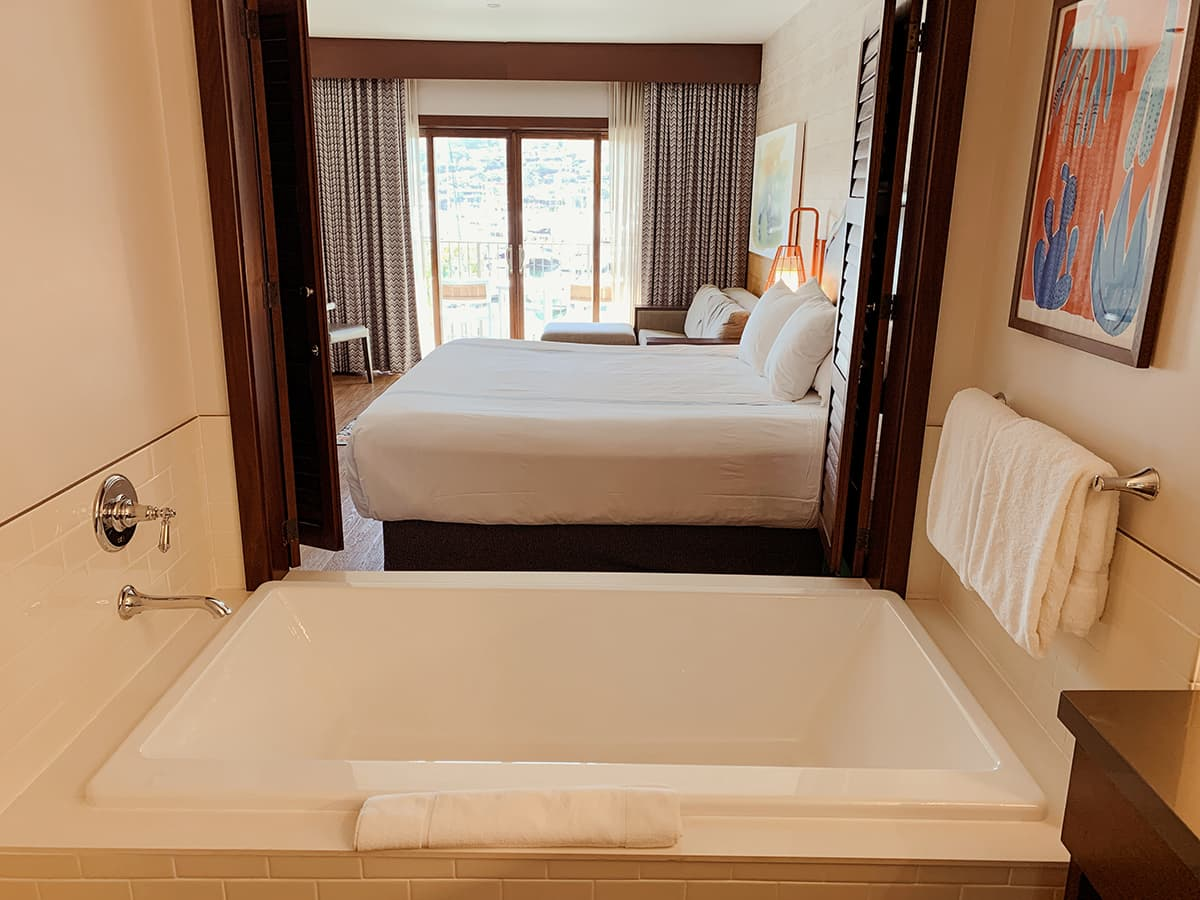 suite with king bed and deep tub